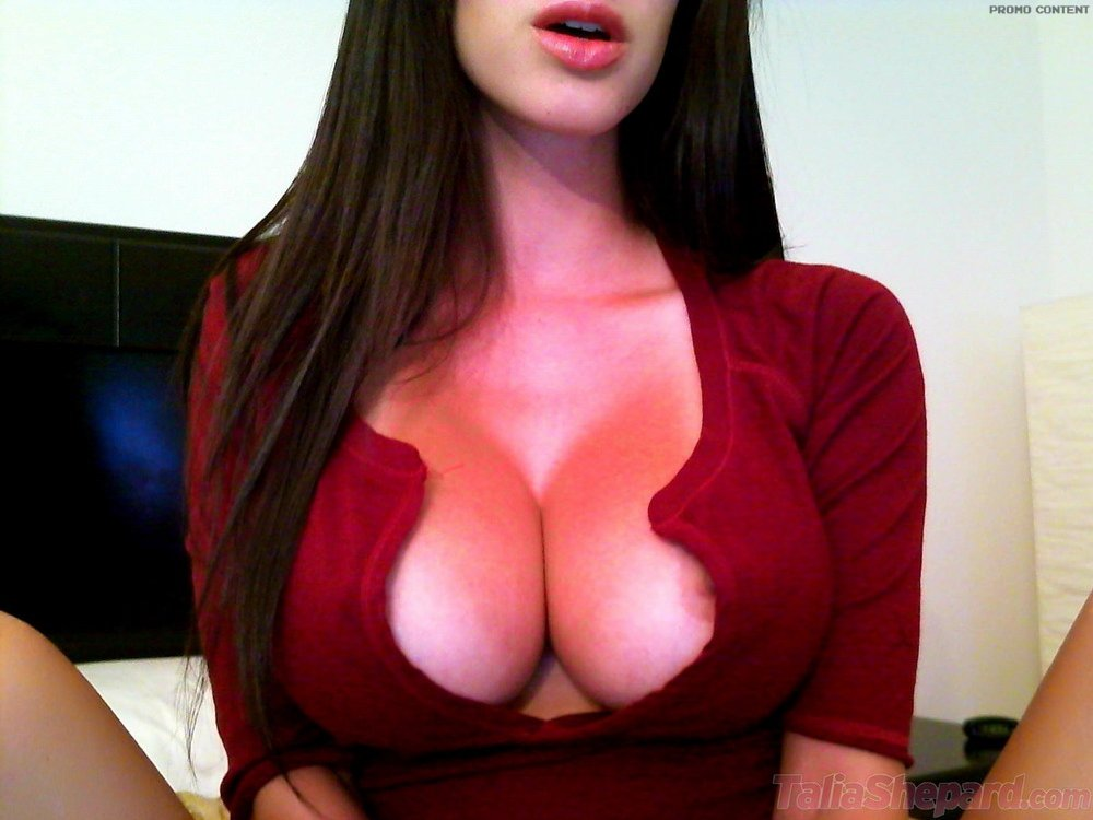 Big tits busting out of shirt