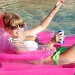 diddylicious drinking a beer on her pool float