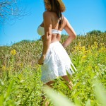 nikki sims white bra and ress in a field