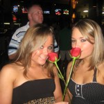 blonde twins together with roses