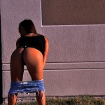 briana lee bent over with her skirt pulled down