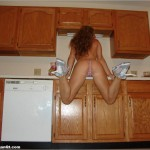 megan qt topless in her thong and sneakers in the kitchen