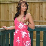 bailey knox in her cute sun dress on a back porch