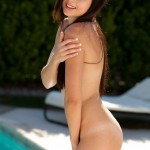 natasha belle shy and naked in front of her swimming pool